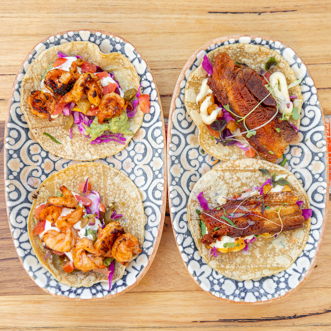 Mexican Food: Chilli Grilled Prawn and Crispy Pork Belly Tacos served on a plate